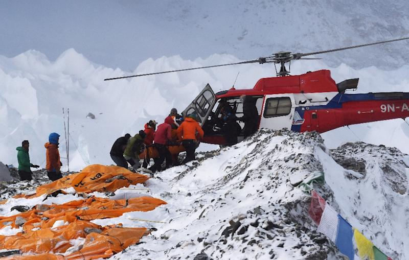 An injured person is loaded onto a rescue helicopter at Everest Base Camp on April 26, 2015, a day after an avalanche triggered by an earthquake devastated the camp (AFP Photo/Roberto Schmidt)
