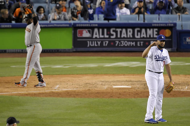 Los Angeles Dodgers relief pitcher Kenley Jansen, right, gestures after San Francisco Giants' Pablo Sandoval, left, fouled out to end a baseball game Saturday, June 16, 2018, in Los Angeles. (AP Photo/Mark J. Terrill)