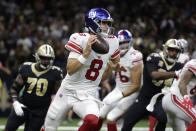 New York Giants quarterback Daniel Jones (8) scrambles in the first half of an NFL football game against the New Orleans Saints in New Orleans, Sunday, Oct. 3, 2021. (AP Photo/Derick Hingle)