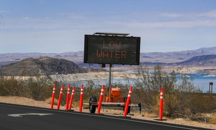 Lake Mead, NV - June 28: A sign warns visitors of the drought's effect at Hemenway Harbor, Lake Mead, Nevada Monday, June 28, 2021. Lake Mead is at its lowest level in history since it was filled 85 years ago, Monday, June 28, 2021. The ongoing drought has made a severe impact on Lake Mead and a milestone in the Colorado River's crisis. High temperatures, increased contractual demands for water and diminishing supply are shrinking the flow into Lake Mead. Lake Mead is the largest reservoir in the U.S., stretching 112 miles long, a shoreline of 759 miles, a total capacity of 28,255,000 acre-feet, and a maximum depth of 532 feet. (Allen J. Schaben / Los Angeles Times)