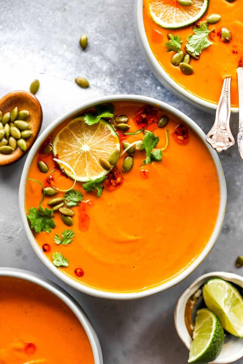"""<p>If you're hungry, whip up this easy Thai soup. It takes less than 30 minutes to make, and is vegan and gluten-free. Top it off with your favorite seeds and a dash of cilantro. </p> <p><strong>Get the recipe</strong>: <a href=""""https://dishingouthealth.com/thai-pumpkin-soup/"""" class=""""link rapid-noclick-resp"""" rel=""""nofollow noopener"""" target=""""_blank"""" data-ylk=""""slk:Thai pumpkin soup"""">Thai pumpkin soup</a></p>"""