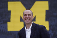 """University of Michigan associate athletic director Kurt Svoboda poses for a photo in Ann Arbor, Mich., July 7, 2021. Schools across the nation are scrambling to come up with policies for their athletes, who can now earn money based on their fame and celebrity. Svoboda says schools are in """"uncharted waters."""" (AP Photo/Paul Sancya)"""