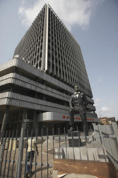 In this photo taken Sunday, March. 25, 2012, The Church Missionary Society Bookshop house and tower (CMS Bookshop) was built in 1973 by G Cappa and designed by Architects Godwin and Hopwood with sun screening and windows to reduce the heat load on the air-conditioning. It is still one of the few buildings in Nigeria to have a facade correctly designed to exclude direct sunlight between 9am and 5pm with a consequent astonishing 75% saving in air-conditioning loading on the office floors, in Lagos, Nigeria. What is predicted to become the most populous city in Africa was initially ignored by the Portuguese explorers who first dominated it, served as a hub for a brutal slave trade and once held the hope of a continent that even now struggles to overcome its colonial past.(AP Photos/Sunday Alamba)