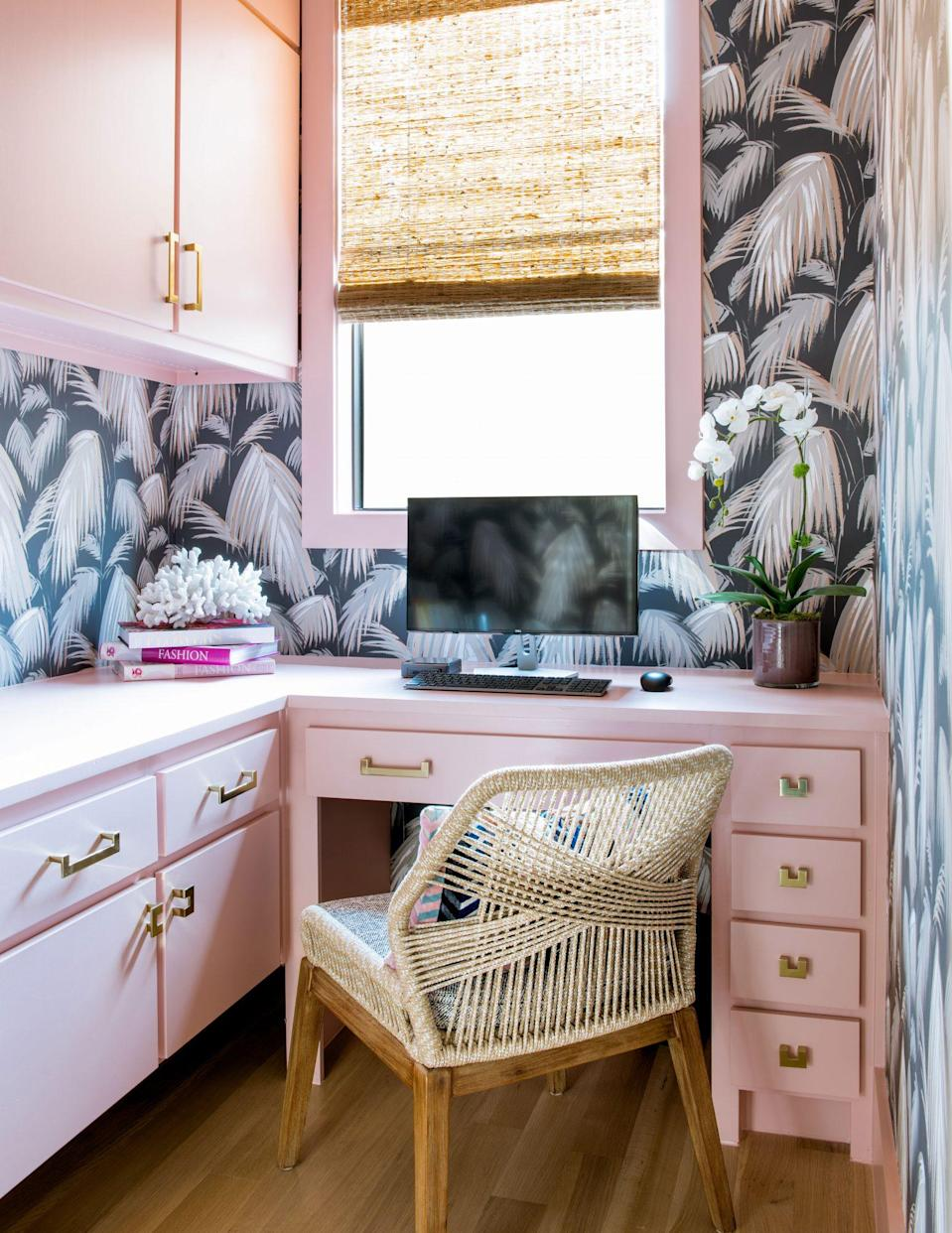 """<p>Vanderford and Jones encourage readers to have fun with color and pattern in tight quarters, too. """"While this space may be small, it is full of cheer. By selecting a light but glamorous <a href=""""https://www.benjaminmoore.com/en-us/color-overview/find-your-color/color/2173-50/coral-dust?color=2173-50"""" rel=""""nofollow noopener"""" target=""""_blank"""" data-ylk=""""slk:pink"""" class=""""link rapid-noclick-resp"""">pink</a> shade for this home workspace, we were able to create a powerful and bright interior that inspires you to get to work,"""" they say. """"We always suggest to our clients to select a bright color for smaller spaces; it's the perfect opportunity to be bold and show off your personality.""""</p>"""