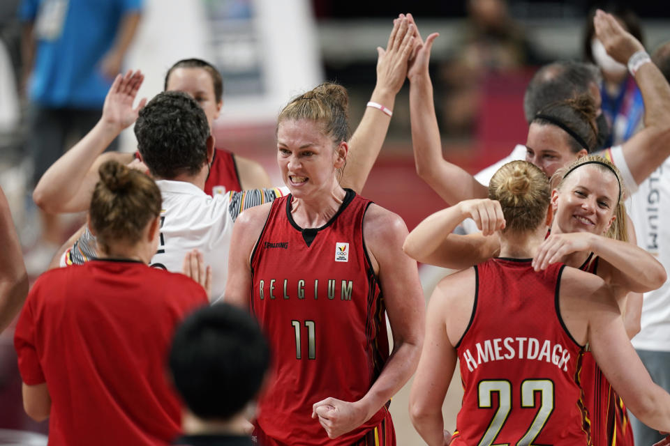 Belgium's Emma Meesseman (11) celebrates with teammates at the end of a women's basketball preliminary round game against Australia at the 2020 Summer Olympics, Tuesday, July 27, 2021, in Saitama, Japan. (AP Photo/Charlie Neibergall)