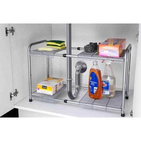 <p>This <span>Home Basics 2-Tier Cabinet Organizer</span> ($35) works great in spaces with awkward pipes.</p>