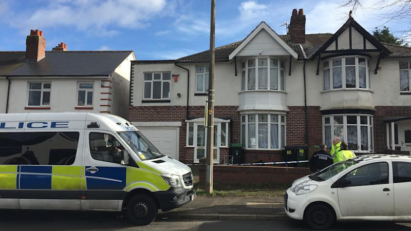 Son charged with murdering mother and stepfather at couple's home