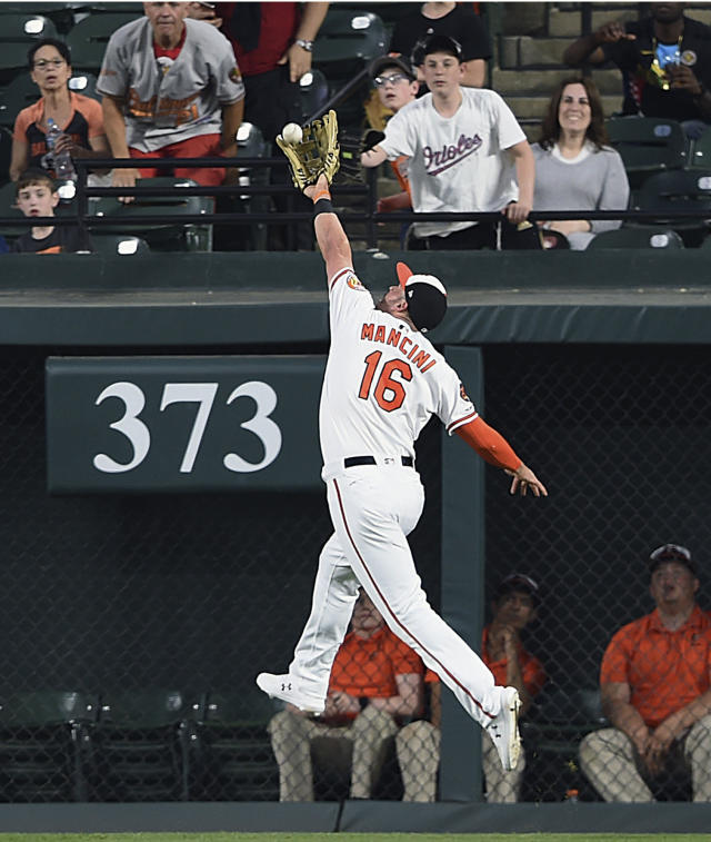 Baltimore Orioles' Trey Mancini makes a leaping catch on a ball hit by Chicago White Sox's Jose Abreu in the third inning of a baseball game, Tuesday, April 23, 2019, in Baltimore. (AP Photo/Gail Burton)