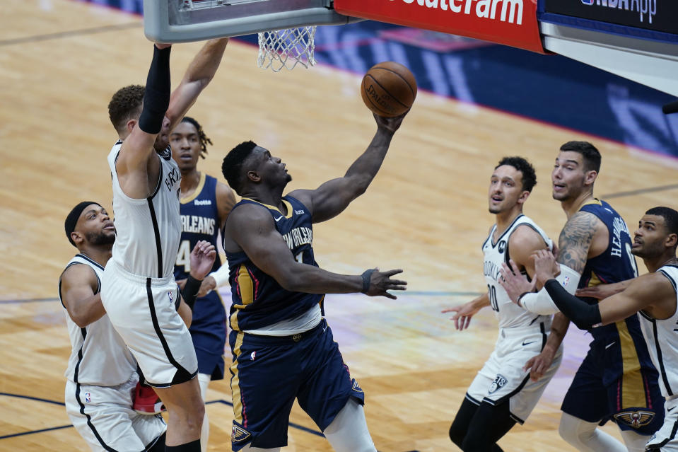 New Orleans Pelicans forward Zion Williamson (1) goes to the basket in the second half of an NBA basketball game against the Brooklyn Nets in New Orleans, Tuesday, April 20, 2021. The Nets won 134-129. (AP Photo/Gerald Herbert)