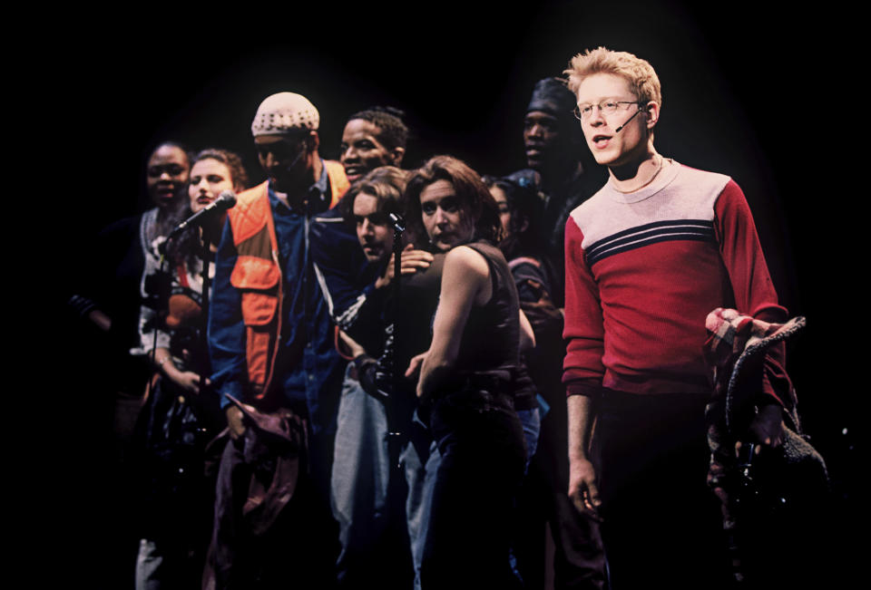 """Anthony Rapp, right, and the cast appear during a performance of the 1996 musical """"Rent""""in New York. The New York Theater Workshop will celebrate the 25th anniversary of """"Rent"""" with a gala on March 2 that will be available to stream through March 6. Original cast members will be joined by theater stars such as Lin-Manuel Miranda, Neil Patrick Harris and Ben Platt. (Joan Marcus/Matt Ross Public Relations via AP)"""