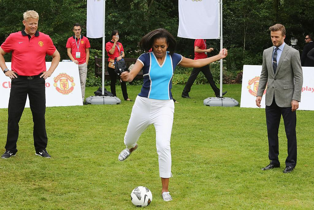 "No pressure or anything, Mrs. Obama, but one of the world's best soccer players is standing behind you watching you play his game! The first lady showed off her soccer skills when she joined pro player David Beckham at a ""Let's Move"" event at the U.S. ambassador's residence in London on Friday. (7/27/2012)"