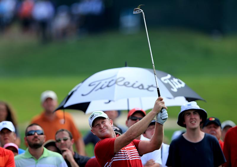 Jamie Donaldson of Wales hits an approach shot on the first hole during the final round of the 96th PGA Championship at Valhalla Golf Club on August 10, 2014 in Louisville, Kentucky