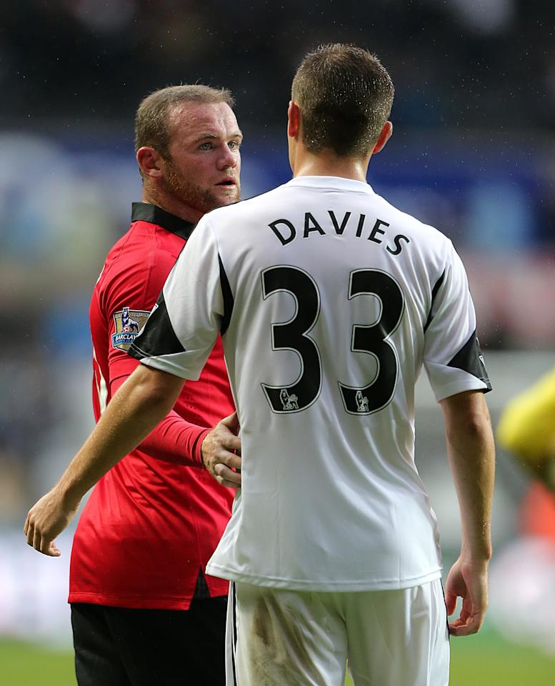 Swansea City's Ben Davies(right) and Manchester United's Wayne Rooney speak after the final whistle