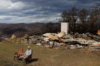 Donald Graham, 68, sits to be interviewed by Reuters beside his home which was destroyed by bushfires in Buchan, Victoria, Australia