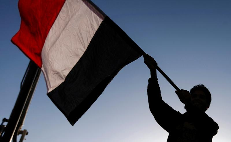A Yemeni waves a national flag during a rally celebrating the death of Yemeni ex-president Ali Abdullah Saleh a day after he was killed, in the capital Sanaa on December 5, 2017 (AFP Photo/MOHAMMED HUWAIS)