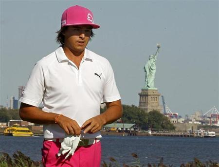 Fowler of the U.S. walks off the 14th green during the third round of the Barclays PGA golf tournament in Jersey City