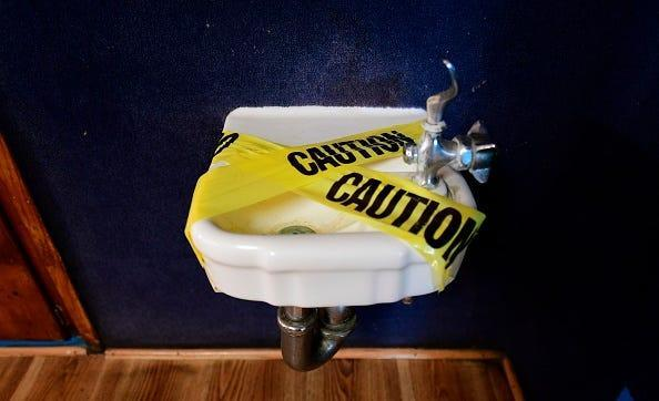 A water fountain is covered with tape and inaccessible as per coronavirus guidelines, during summer school sessions at Happy Day School in Monterey Park, California on July 9, 2020. California Governor Gavin Newsom says the reopening of California schools for the coming school year will be based on safety and not pressure from President Donald Trump as California sets records for one-day increases in COVID-19 cases.