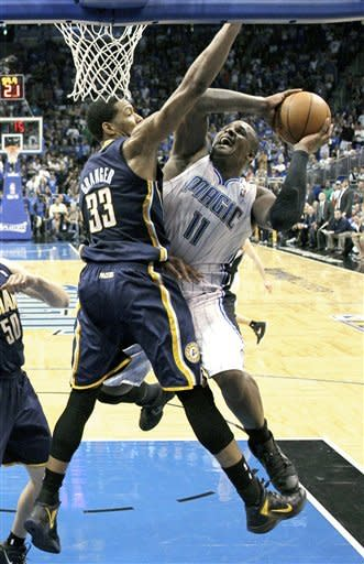Indiana Pacers' Danny Granger (33) tries to block a shot by Orlando Magic's Glen Davis (11) during the second half of Game 4 of an NBA first-round playoff basketball series, Saturday, May 5, 2012, in Orlando, Fla. Indiana won in overtime 101-99.(AP Photo/John Raoux)