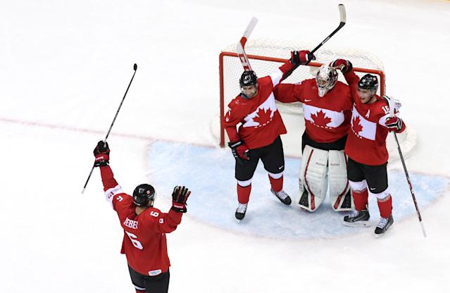 SOCHI, RUSSIA - FEBRUARY 23: Shea Weber #6, Carey Price #31, Dan Hamhuis #5 and Jonathan Toews #16 of Canada celebrate after defeating Sweden 3-0 during the Men's Ice Hockey Gold Medal match on Day 16 of the 2014 Sochi Winter Olympics at Bolshoy Ice Dome on February 23, 2014 in Sochi, Russia. (Photo by Bruce Bennett/Getty Images)