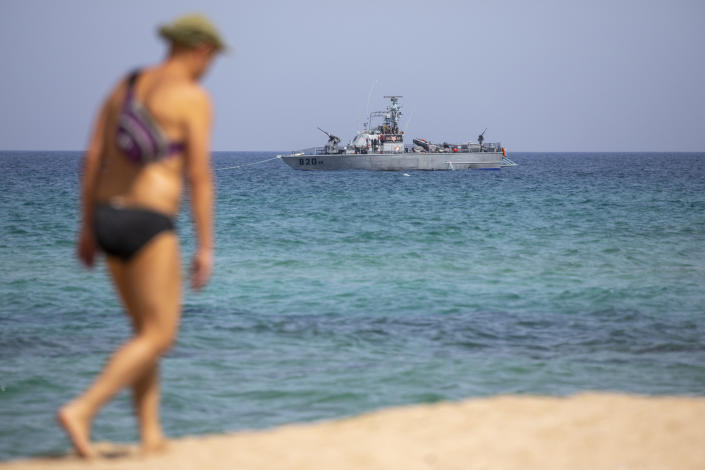 An Israeli Navy vessel anchored in the Mediterranean Sea, as seen from the Rosh Hanikra border crossing between Israel and Lebanon in northern Israel, Tuesday, May 4, 2021. Lebanon and Israel have resumed indirect talks with U.S. mediation at a U.N. post along the border known as Ras Naqoura over their disputed maritime border after nearly a six-month pause. (AP Photo/Ariel Schalit)