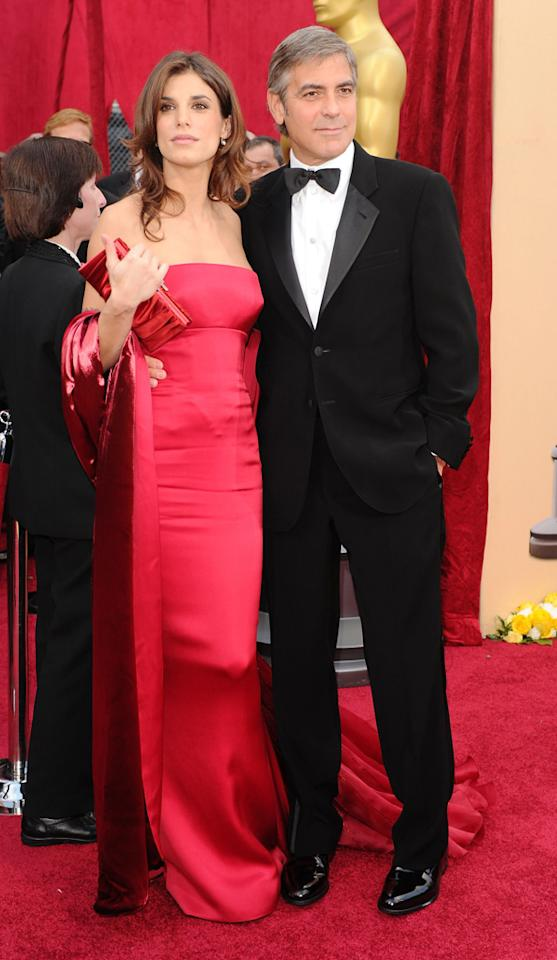 "George Clooney   Grade: B    No one wears a classic tux better than gorgeous George (pictured here with girlfriend Elisabetta Canalis). But what was up with the ""Up in the Air"" Best Actor nominee's limp feathered silver coif?"