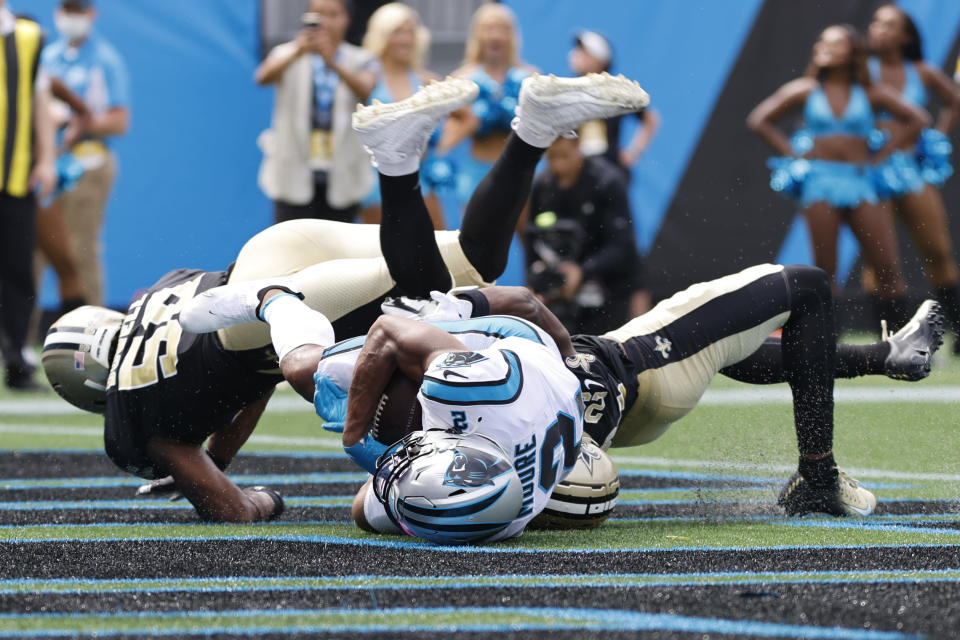 Carolina Panthers wide receiver D.J. Moore scores against the New Orleans Saints during the first half of an NFL football game Sunday, Sept. 19, 2021, in Charlotte, N.C. (AP Photo/Nell Redmond)