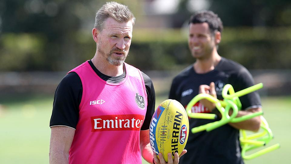 Pictured here, Collingwood coach Nathan Buckley at a Magpies training session.