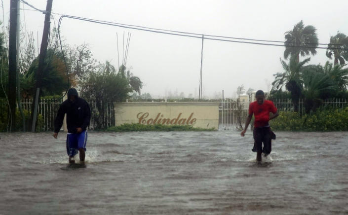 Residents wade through a street flooded with water brought on by Hurricane Dorian in Freeport, Bahamas, Sept. 3, 2019. (Photo: Ramon Espinosa/AP)