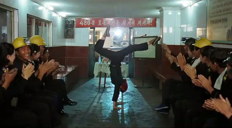 "In this image made out of film ""Comrade Kim Goes Flying"" released by Another Dimension of An Idea/Koryo Group, Comrade Kim Yong Mi played by Han Jong Sim, center, receives applause from her coal mine comrades for her acrobatic performance. It's a classic tale of a small town girl who follows her dreams to the big city. But in this case, the girl is a North Korean coal miner, the big city is Pyongyang and her dream is to become a high-flying trapeze artist. ""Comrade Kim Goes Flying,"" a collaboration between a North Korean director and two European filmmakers, makes its world premiere Saturday, Sept. 8, 2012 at the Toronto International Film Festival before it heads to Pyongyang later this month for its North Korean debut. (AP Photo/Courtesy of Another Dimension of An Idea/Koryo Group) EDITORIAL USE ONLY"