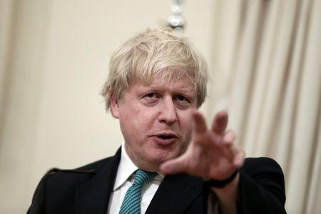 British Foreign Secretary Johnson answers a question during a joint press conference with Greek Foreign Minister Kotzias following their meeting at the Foreign Ministry in Athens