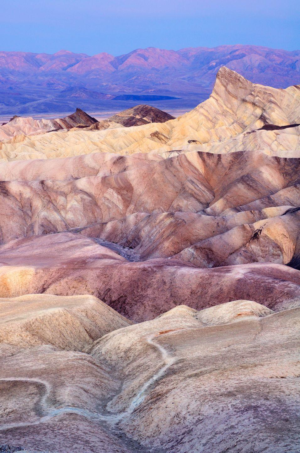 <p><strong>Where: </strong>Death Valley National Park, California</p><p><strong>Why We Love It: </strong>Located on the eastern border of California, Death Valley is America's lowest, hottest, and driest point. But that doesn't make watching the sunset from Zabriskie Point any less beautiful.</p>