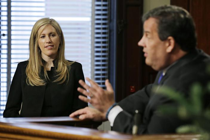 Deborah Gramiccioni, left, listens as New Jersey Gov. Chris Christie announces in Trenton, N.J., Friday, Dec. 13, 2013, that she is his choice to replace Bill Baroni as executive deputy director of Port Authority of New York and New Jersey . Christie announced that Baroni, one of his top appointees, had the resigned Friday amid an escalating probe into ramp closings on a bridge into New York City. Christie said he was certain the shutdowns were not politically motivated. The resignation of Baroni comes a day after the Democratic National Committee tried to link Christie, a Republican, to the controversy and a state lawmaker issued seven subpoenas to Baroni and other agency officials. (AP Photo/Mel Evans)