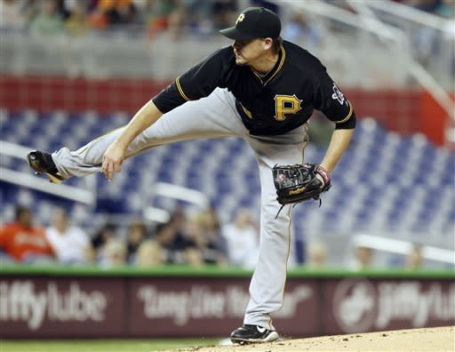 Pittsburgh Pirates starter Kevin Correia throws to the Miami Marlins during the second inning of a baseball game in Miami, Tuesday, May 15, 2012. (AP Photo/J Pat Carter)