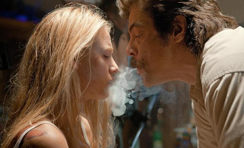 """This film image released by Universal Pictures shows Blake Lively, left, and Benicio Del Toro in a scene from """"Savages."""" (AP Photo/Universal Pictures, Francois Duhamel)"""