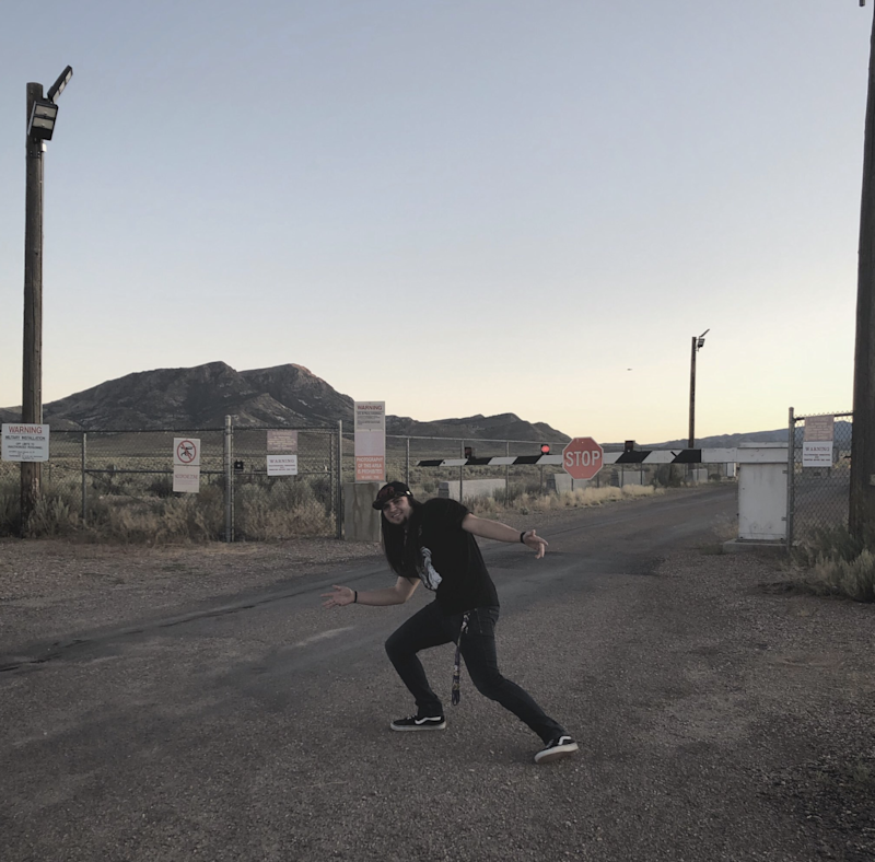 Matty Roberts stands outside Area 51 in Nevada.
