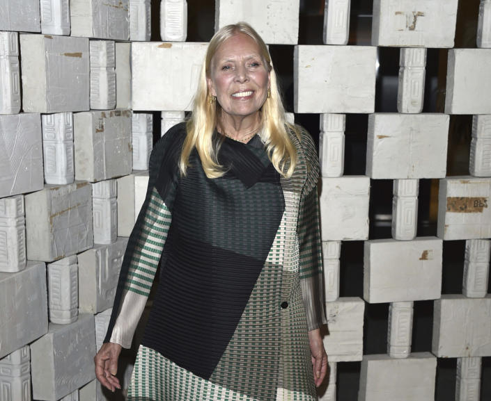 """FILE - In this Oct. 11, 2014 file photo, Joni Mitchell arrives to the Hammer Museum's """"Gala In The Garden,"""" in Los Angeles. The Kennedy Center Honors is returning in December with a class that includes Motown Records creator Berry Gordy, """"Saturday Night Live"""" mastermind Lorne Michaels and actress-singer Bette Midler. Organizers expect to operate at full capacity, after last year's Honors ceremony was delayed for months and later conducted under intense COVID-19 restrictions. (Photo by John Shearer/Invision/AP, File)"""