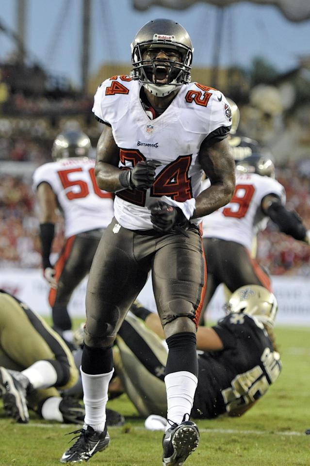 Tampa Bay Buccaneers cornerback Darrelle Revis (24) celebrates after the defense stopped the New Orleans Saints during the second quarter of an NFL football game on Sunday, Sept. 15, 2013, in Tampa, Fla. (AP Photo/Brian Blanco)