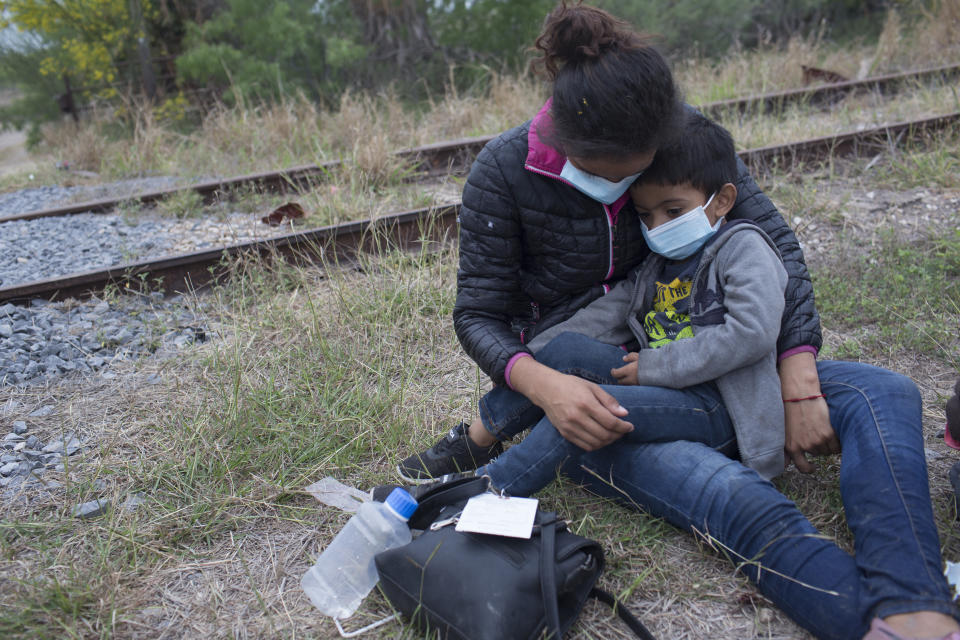 Refugee families from Central America, many with small children, are detained by Border Patrol agents after crossing from Mexico into the United States, on April 14, 2021 in La Joya, Texas. ( Andrew Lichtenstein/Corbis via Getty Images)