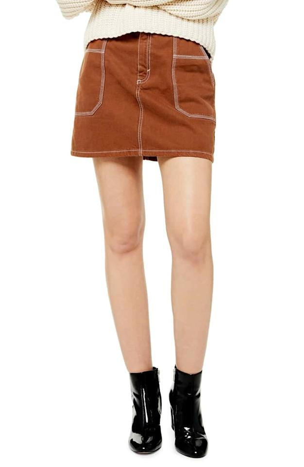 "$55, Nordstrom. <a href=""https://shop.nordstrom.com/s/topshop-topstitch-twill-miniskirt/5301205?origin=keywordsearch-personalizedsort&breadcrumb=Home%2FAll%20Results&color=brown"">Get it now!</a>"