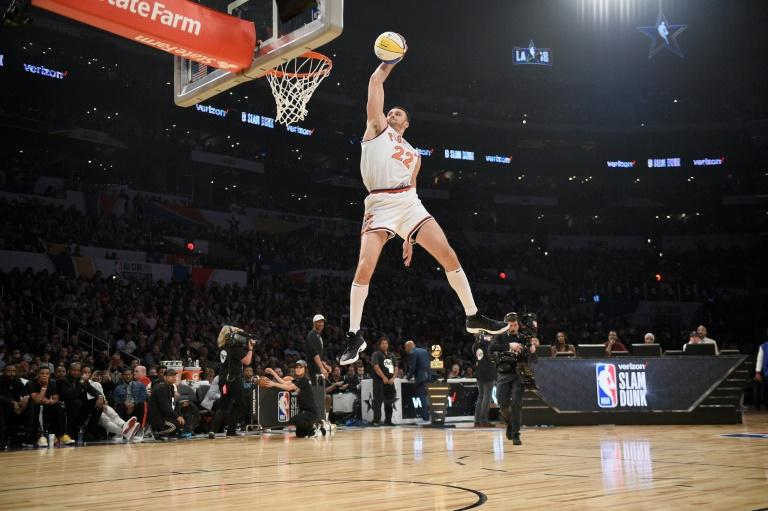 Larry Nance Jr. of the Cleveland Cavaliers, wearing his dad's jersey, competes in the 2018 Verizon Slam Dunk Contest