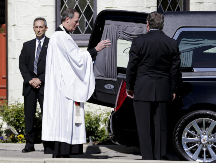 <p>The Rev. Stuart Kenworthy, vicar of the Washington National Cathedral, gives the final blessing after the casket carrying former first lady Nancy Reagan was loaded into a hearse at a mortuary in Santa Monica, Calif., on Wednesday. <i>(Photo: Jae C. Hong, Pool/AP)</i></p>