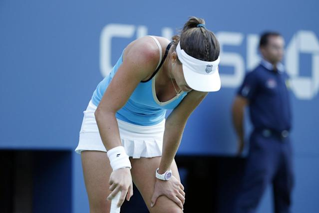 Alexandra Dulgheru, of Romania, reacts after losing a point against Maria Sharapova, of Russia, during the second round of the U.S. Open tennis tournament Wednesday, Aug. 27, 2014, in New York. (AP Photo/Jason DeCrow)