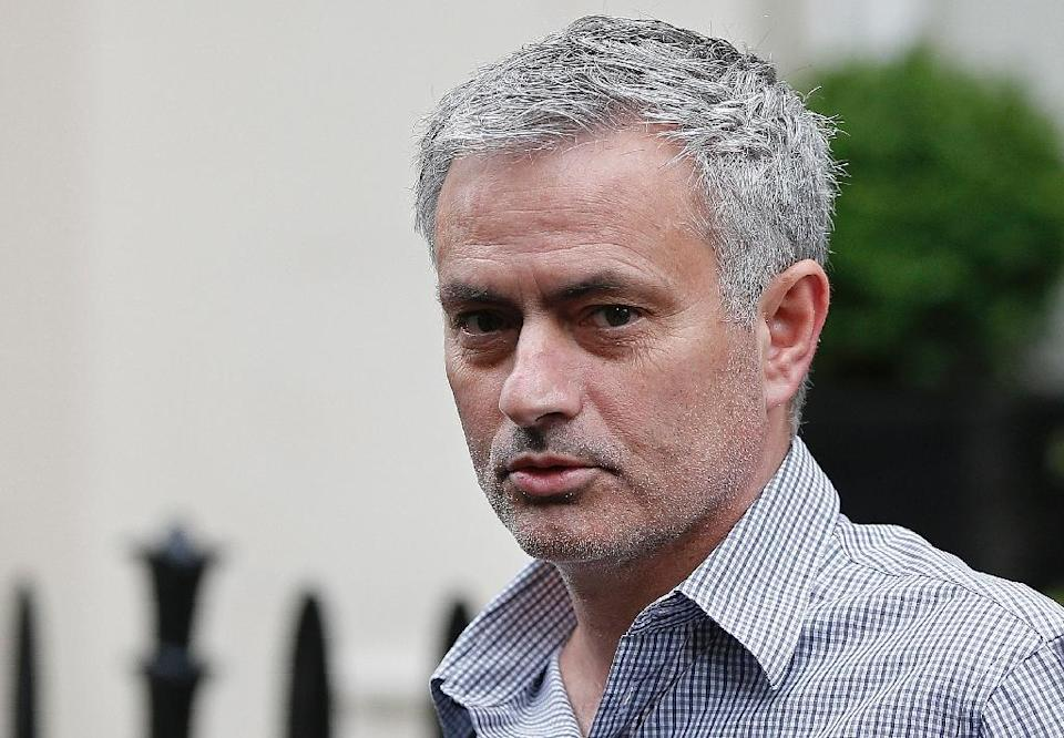 """Manchester United said in a statement that Jose Mourinho had signed a three-year contract with an option to stay until """"at least 2020"""" (AFP Photo/Adrian Dennis)"""