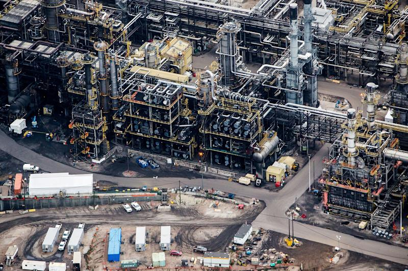 The Suncor Energy Inc. Millennium upgrader plant is seen in this aerial photograph taken above the Athabasca oil sands near Fort McMurray, Alberta, Canada, on Monday, Sept. 10, 2018. While the upfront spending on a mine tends to be costlier than developing more common oil-sands wells, their decades-long lifespans can make them lucrative in the future for companies willing to wait. Photographer: Ben Nelms/Bloomberg via Getty Images