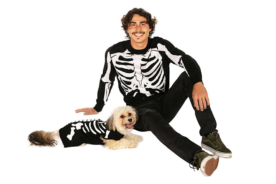 """<p>This is a couple's costume that people like to see. </p> <p><strong>Buy it!</strong> Halloween Skeleton Sweater for Pups + People, $24.99; <a href=""""https://www.petsmart.com/dog/clothing-and-shoes/costumes/tipsy-elves-halloween-skeleton-sweater-for-pups-%2B-people-67122.html"""" rel=""""nofollow noopener"""" target=""""_blank"""" data-ylk=""""slk:PetSmart.com"""" class=""""link rapid-noclick-resp"""">PetSmart.com</a></p>"""