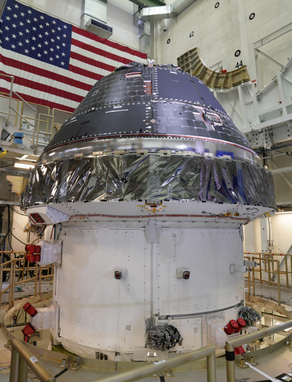 The completed Orion spacecraft crewe module stacked on top of the completed service module in the Operations and Checkout Building at the NASA Kennedy Space Center.