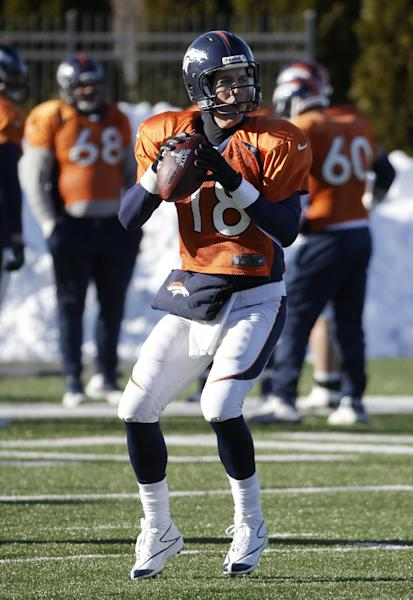 Denver Broncos quarterback Peyton Manning (18) passes during practice Wednesday, Jan. 29, 2014, in Florham Park, N.J. The Broncos are scheduled to play the Seattle Seahawks in the NFL Super Bowl XLVIII football game Sunday, Feb. 2, in East Rutherford, N.J. (AP Photo/Mark Humphrey)