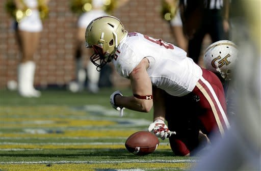 Boston College tight end Chris Pantale, left, looses the ball on a pass in the end zone against the defense of Georgia Tech cornerback Louis Young, right, during the first quarter of an NCAA college football game, Saturday, Oct. 20, 2012, in Atlanta. (AP Photo/David Goldman)