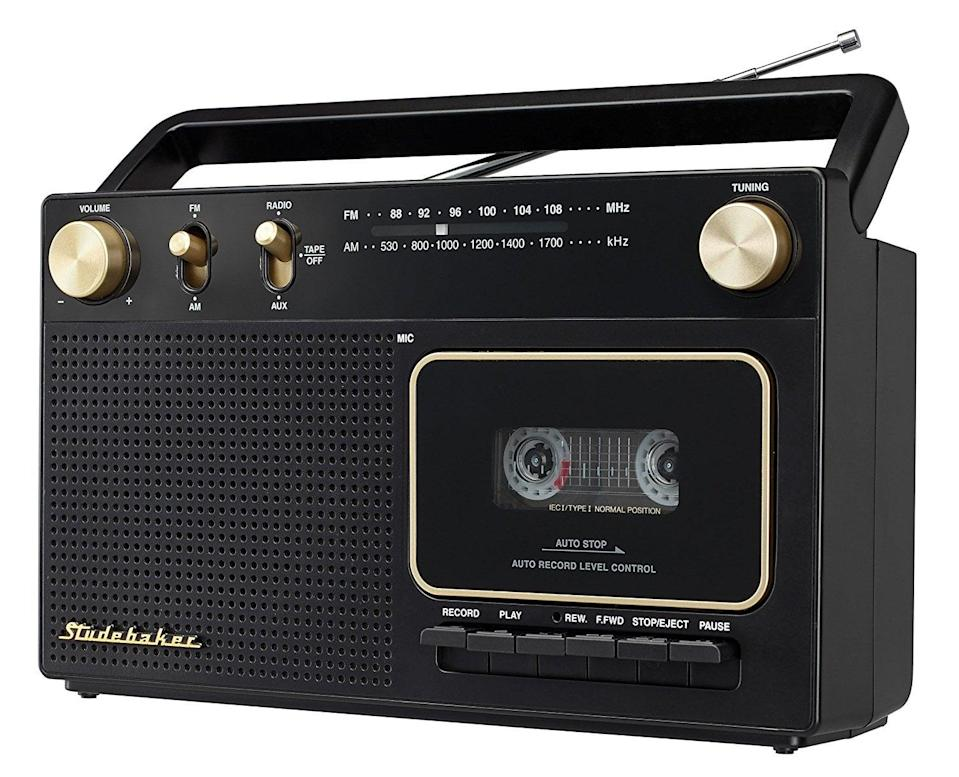 <p>He can listen to his favorite old cassette tapes on this <span>Studebaker Portable Audio Stereo</span> ($40). It also has radio AM/FM capabilities.</p>