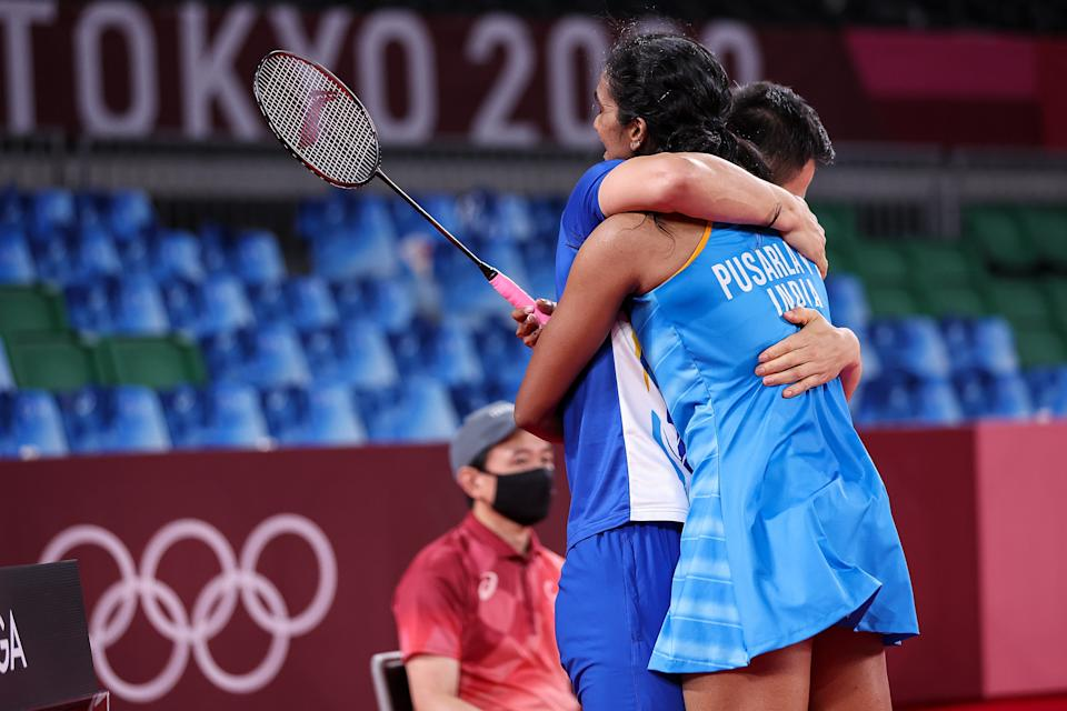 CHOFU, JAPAN - AUGUST 01: Pusarla V. Sindhu of Team India celebrates with her coach Park Tae-sang(left) as she wins against He Bing Jiao of Team China during the Women's Singles Bronze Medal match on day nine of the Tokyo 2020 Olympic Games at Musashino Forest Sport Plaza on August 01, 2021 in Chofu, Tokyo, Japan. (Photo by Lintao Zhang/Getty Images)